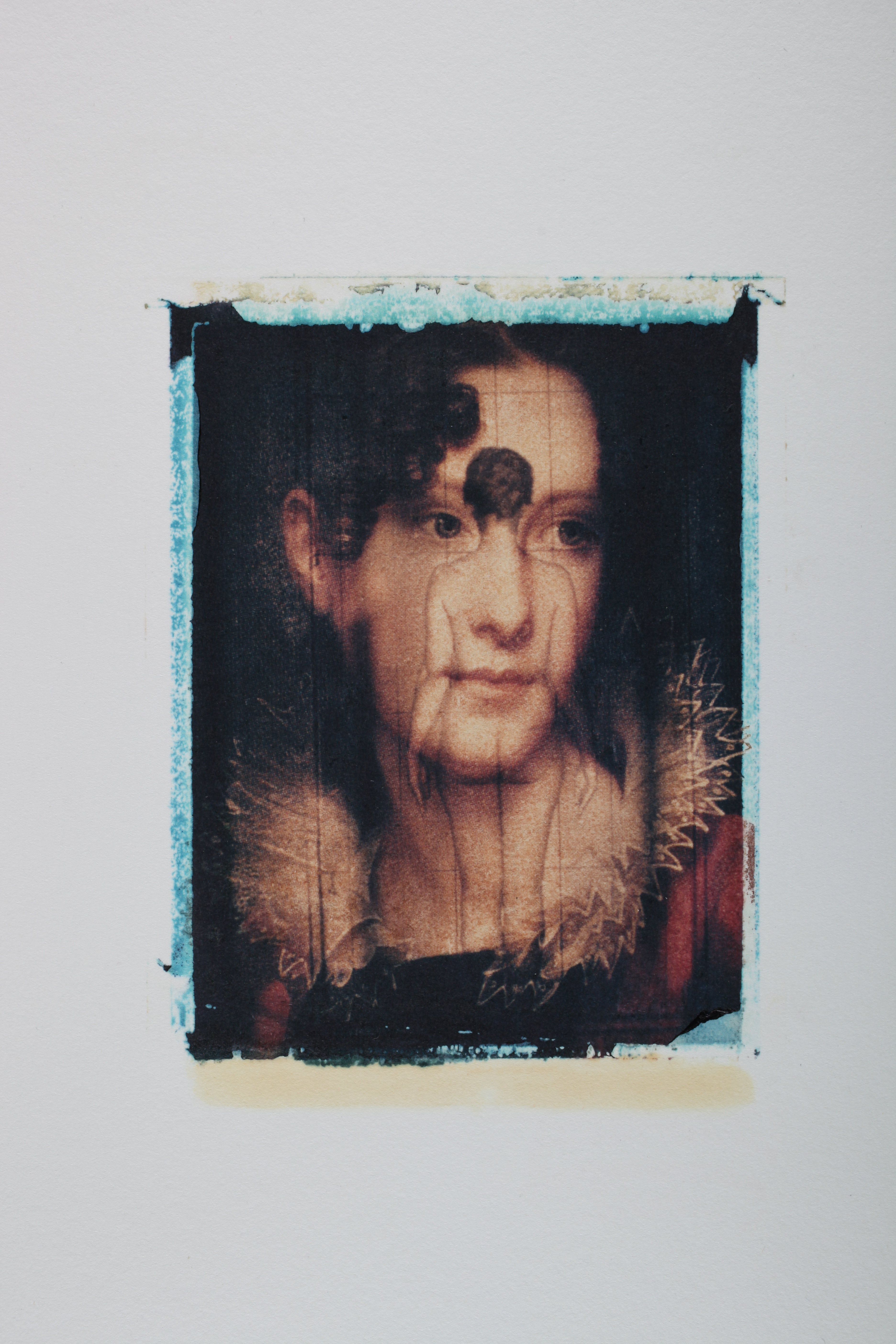 Multi-layered Polaroid image by Robert Seydel with woman's face and backside of nude woman's body
