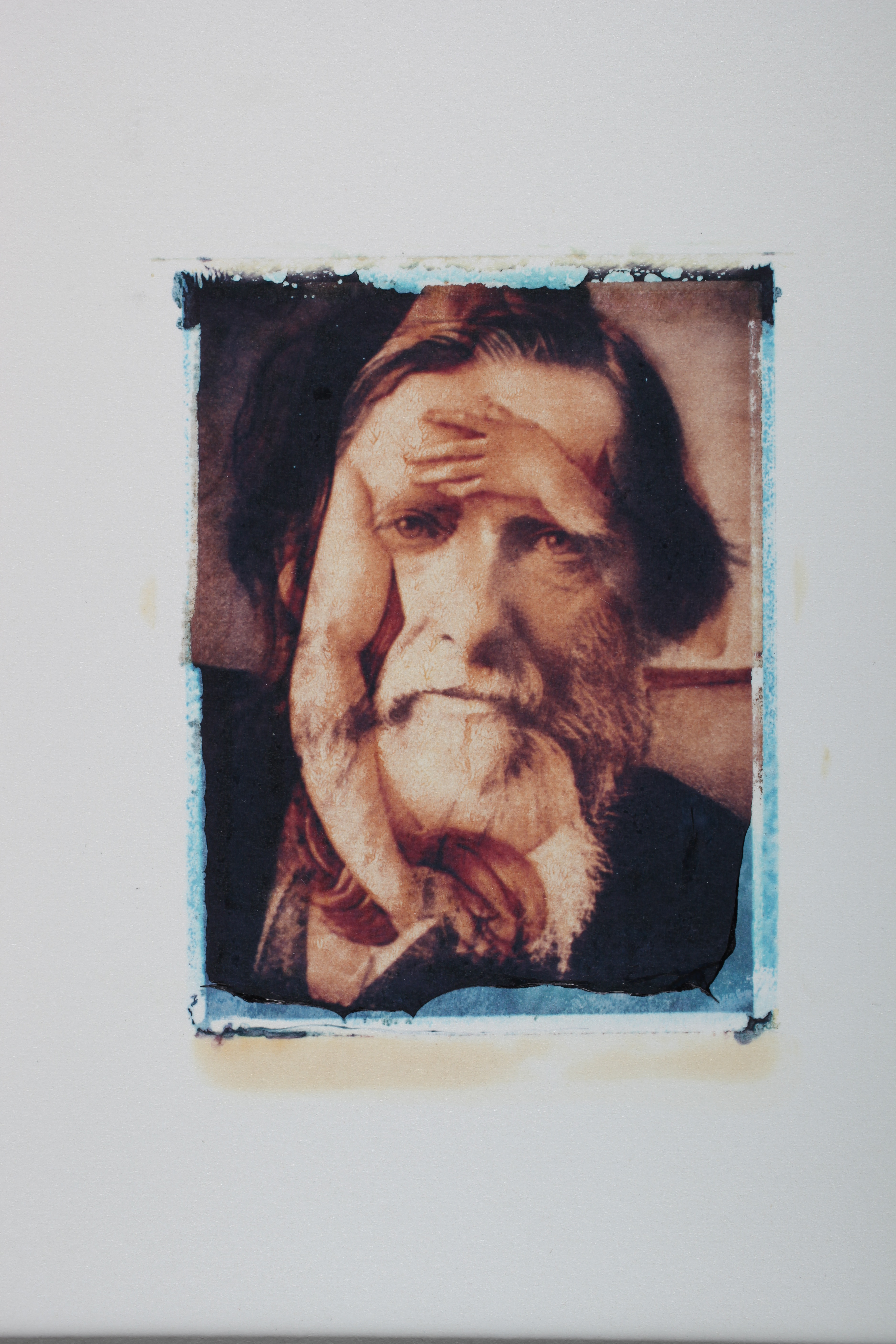 Multi-layered Polaroid image by Robert Seydel with man's bearded face and woman's nude figure